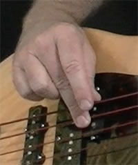 bass plucking hand